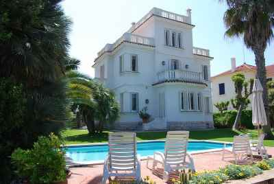 4 story Colonial style house with a huge yard on the shoreline in Sitges